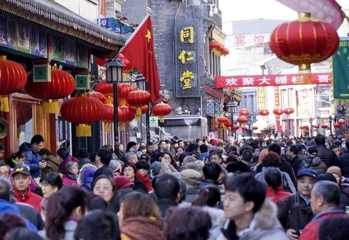 Cina_Pechino_Folla_Lapresse