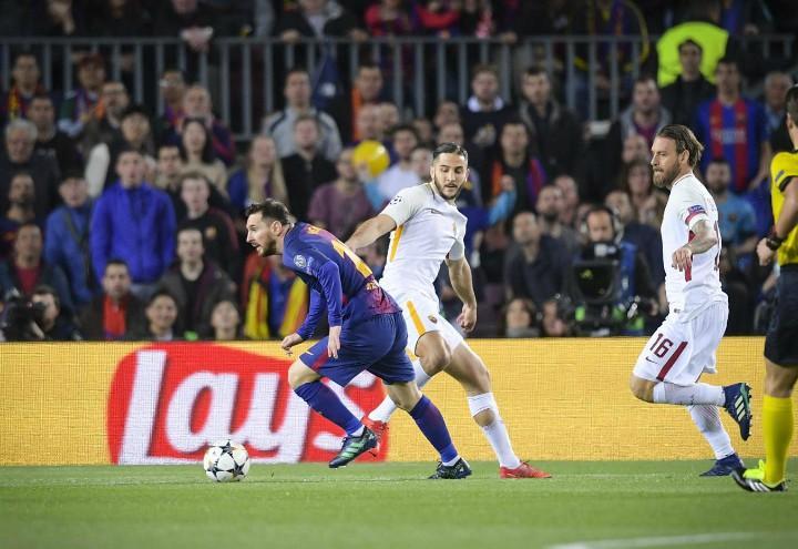 Messi_Manolas_Barcellona_Roma_lapresse_2018