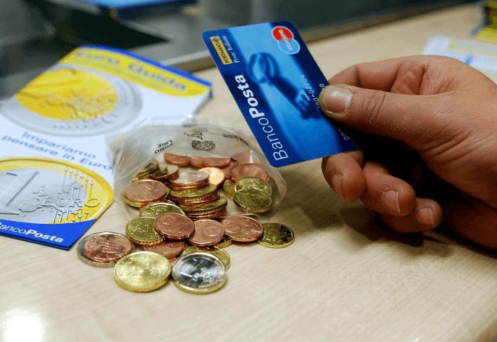 pagamento_pensioni_poste_bancomat_soldi_denaro_monete_lapresse_2018