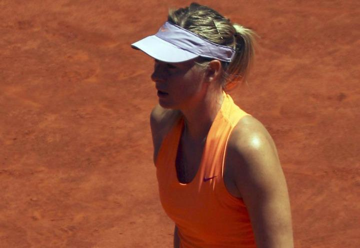 Sharapova_arancione_Madrid_lapresse_2017