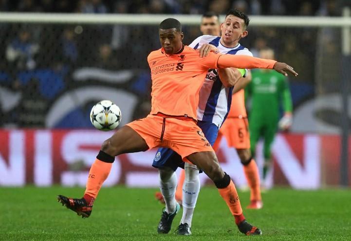 Wijnaldum_Herrera_Porto_Liverpool_lapresse_2018