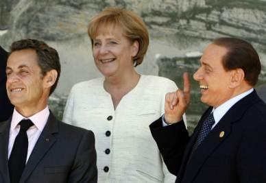 Sarkozy_Merkel_BerlusconiR400