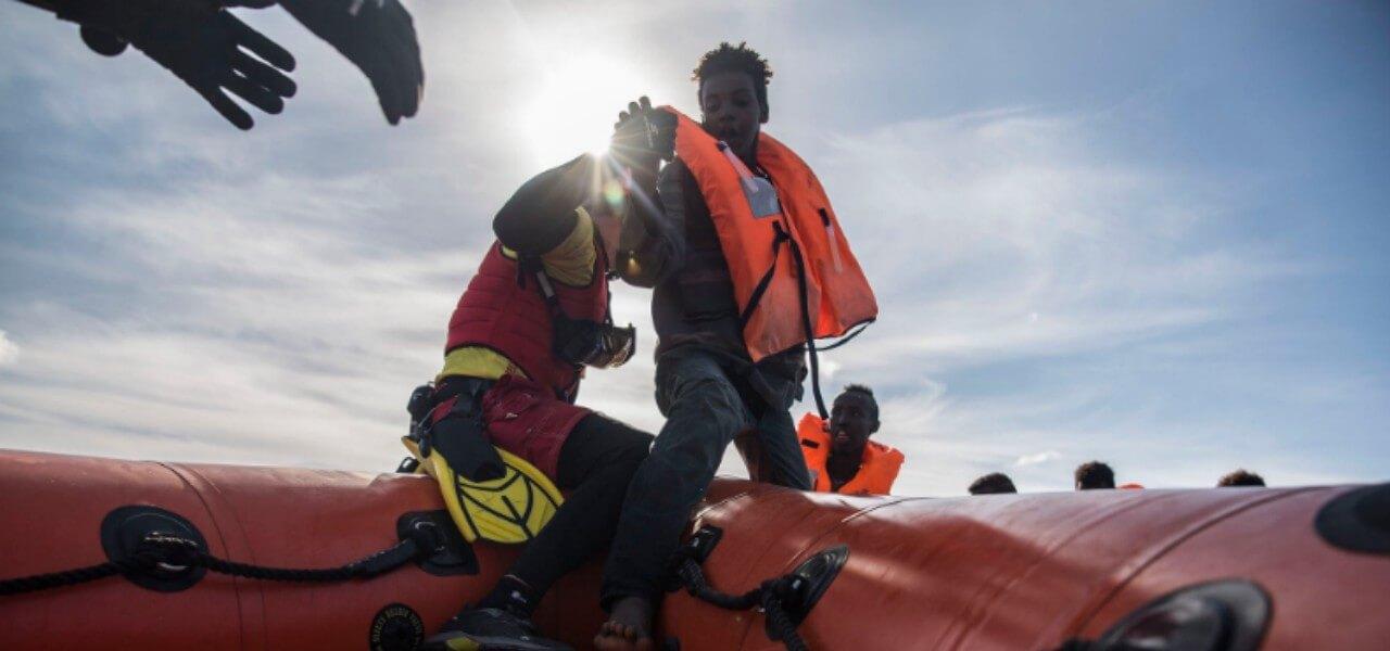 migranti asso 25